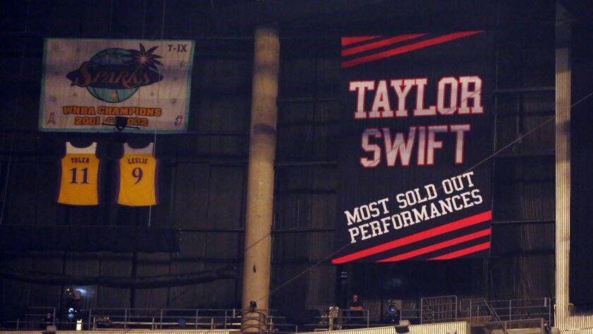 """A banner honoring Taylor Swift is seen during the """"1989"""" world tour at Staples Center on Aug. 22, 2015."""