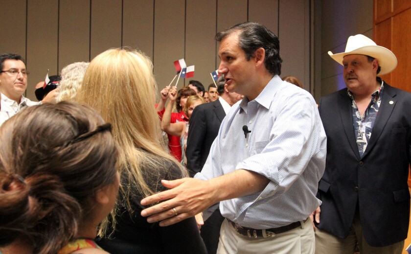 Sen. Ted Cruz, shown greeting people at a Republican Party event in Conroe, Texas, isn't a fan of national healthcare. But it turns out he was born in Canada, which has such a system.
