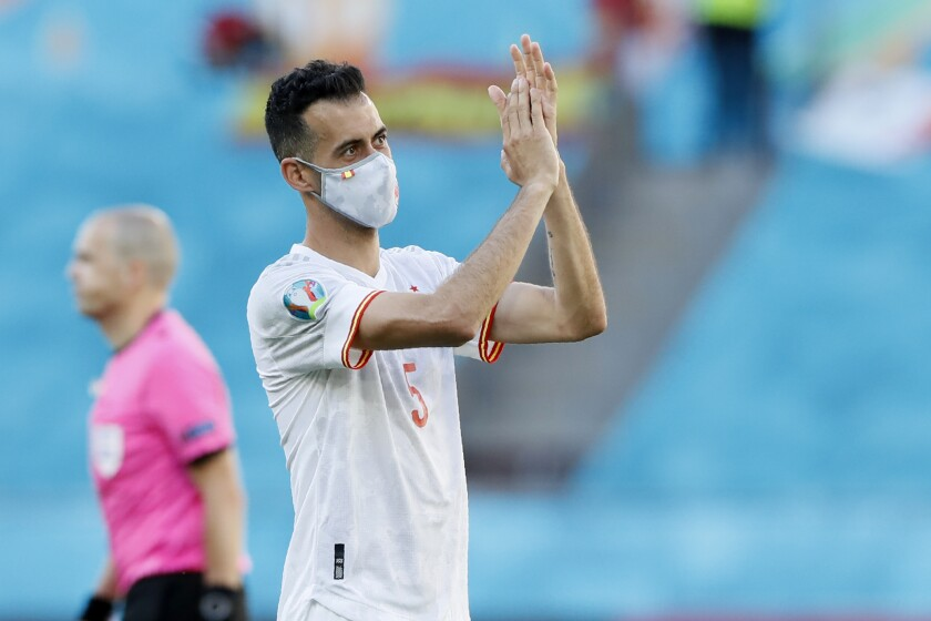 Spain's Sergio Busquets applauds at the end of the Euro 2020 soccer championship group E match between Spain and Slovakia at La Cartuja stadium in Seville, Wednesday, June 23, 2021. (AP Photo/Jose Manuel Vidal, Pool)