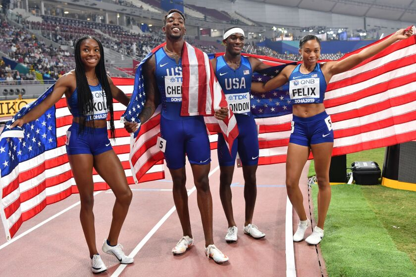 U.S. sprinters Courtney Okolo, Michael Cherry, Wilbert London and Allyson Felix celebrate.