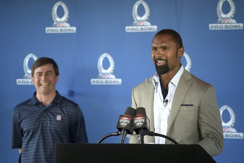 Former NFL defensive back Charles Woodson, right, addresses the audience as Peter O'Reilly, NFL Senior Vice President of Events, listens during news conference announcing Orlando, Fla., as the new host for the NFL Pro Bowl football game in Kissimmee, Fla., Wednesday, June 1, 2016. (AP Photo/Phelan