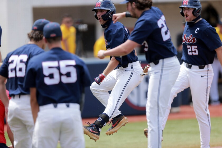 Mississippi batter Justin Bench jumps after his two-run home run against Southern Mississippi in the first inning of an NCAA college baseball tournament regional game Monday, June 7, 2021, in Oxford, Miss. (Thomas Wells/The Northeast Mississippi Daily Journal via AP)