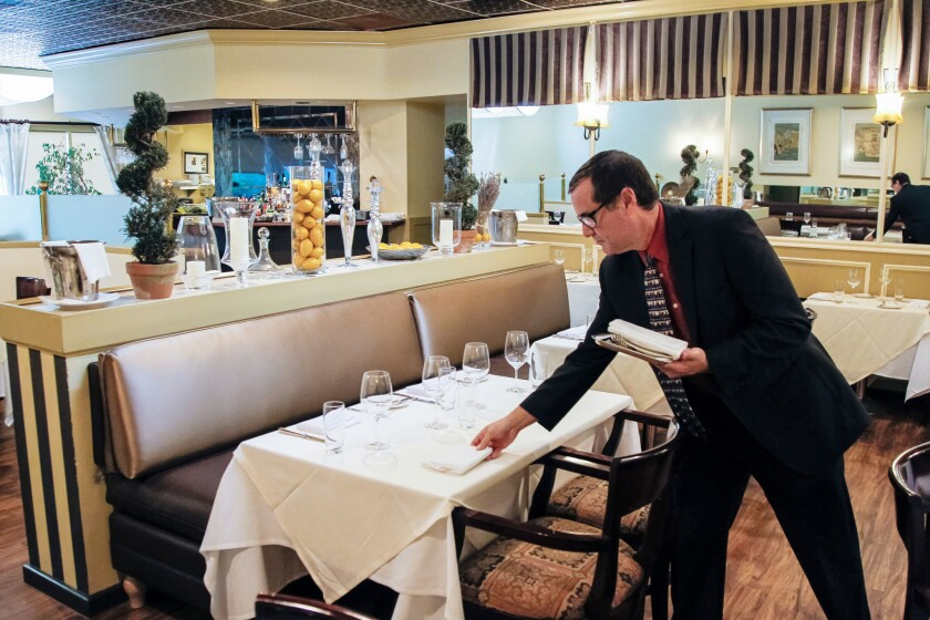 Sommelier Greg Frech gets the details right before dinner service at The WineSellar & Brasserie in Sorrento Mesa.