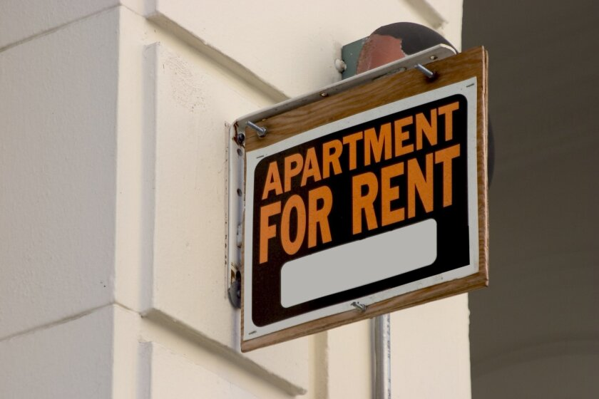 "An ""apartment for rent"" sign."