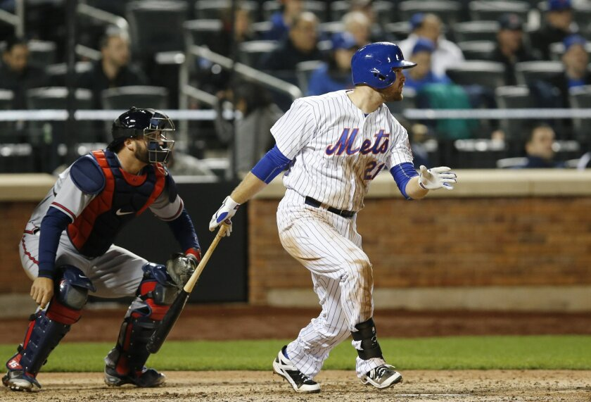 New York Mets Lucas Duda watches his eighth-inning RBI single that scored the go-ahead run in the Mets 3-2 victory over the Atlanta Braves in a baseball game in New York, Wednesday, April 22, 2015. (AP Photo/Kathy Willens)
