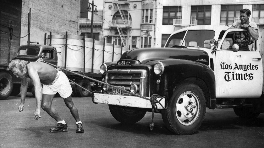 July 14, 1950: While Los Angeles Times truck driver Jessie Leon Moody watches, Leo V. Voss pulls two-ton delivery truck with a rope tied to his hair.