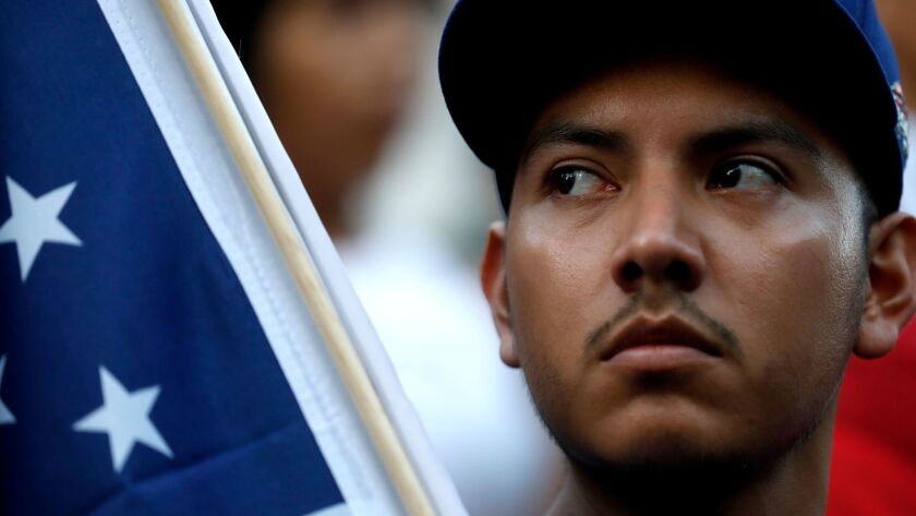 Javier Ortega, 23, demonstrates against changes in DACA immigration policy at City Hall in Los Angeles on Sept. 5.