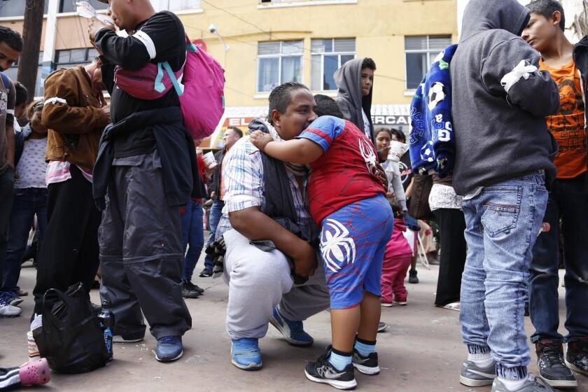 Josue Arebanos with his son Jovanny say goodbye before the march toward the border.