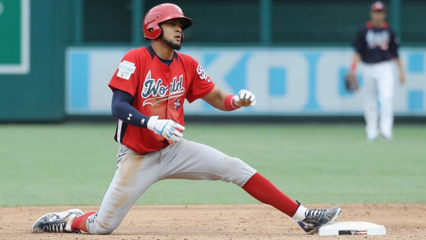 The Padres' Fernando Tatis steals second base in the third inning against the U.S. Team during the SiriusXM All-Star Futures Game at Nationals Park on July 15, 2018 in Washington, DC.