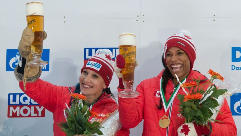 Canada.s winners Kaillie Humphries, left, and Phylicia George celebrate after the women's bob comp
