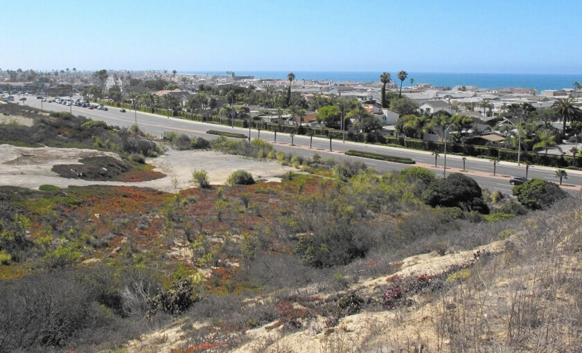 The view from above a Banning Ranch bluff looking south on West Coast Highway. A hearing set for Thursday has been postponed after developer Newport Banning Ranch LLC asked the Coastal Commission for more time.