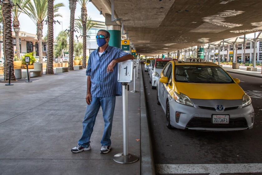 Osman Khaliqi, a yellow cab driver, waits next in line for a fare at the San Diego Airport in August 2020.