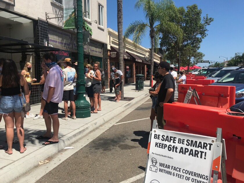 The city has allowed restaurants to extend service onto the street on the 101.