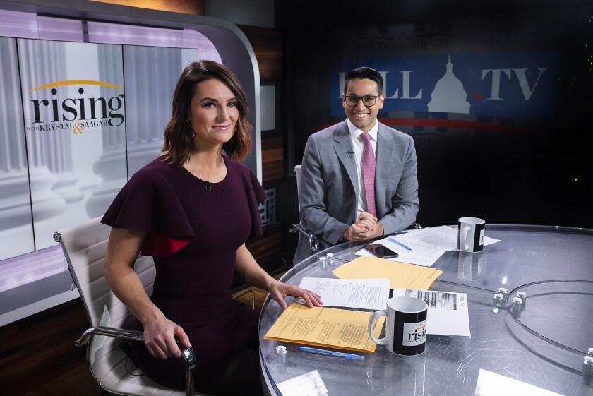 """Rising"" hosts Krystal Ball and Saagar Enjetti."