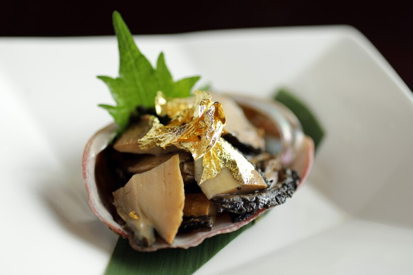 Abalone sashimi with gold leaf at Go's Mart in Canoga Park, serving some of the best seafood in the L.A. area.