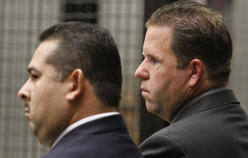Former Fullerton police officers Manuel Ramos, left, and Jay Cicinelli in court in 2012.