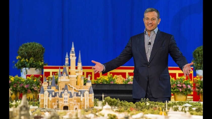 Bob Iger, Disney's chairman and chief executive, unveils a huge model of the Shanghai Disney Resort in a presentation at the Shanghai Expo Centre.