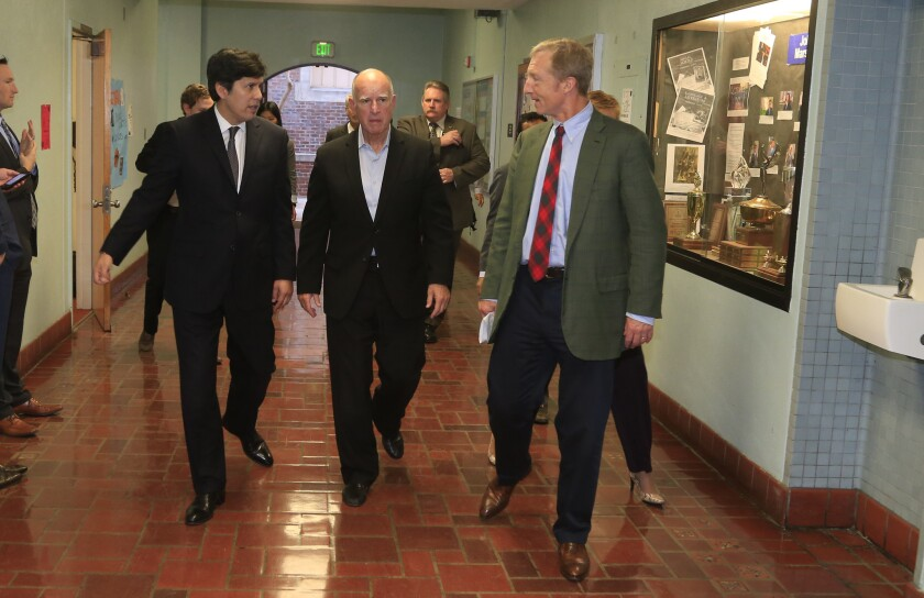 Gov. Jerry Brown, center, Senate President Pro Tem Kevin de León, left, and billionaire green activist Tom Steyer visit John Marshall High School, the first in the L.A. school district to receive Proposition 39 funding for energy efficiency projects.