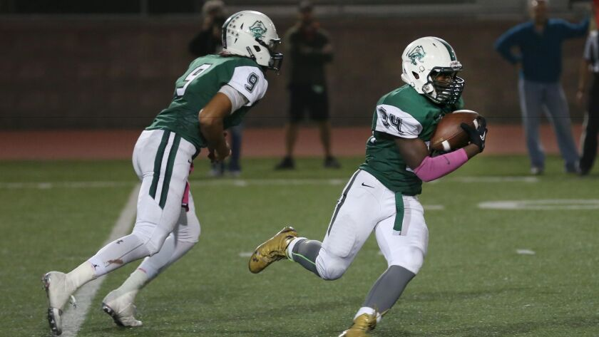 Quarterback Max Shuffer (left) and running back Tevin Meadows played key roles in the Pirates' win over El Camikno.