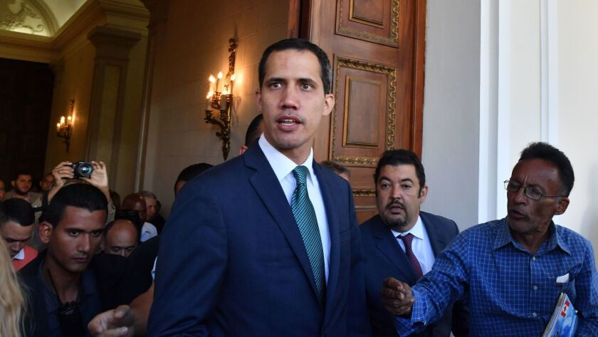 Venezuela's opposition leader and self-proclaimed acting president Juan Guaido arrives at the Federal Legislative Palace, which houses the National Assembly and the National Constitutional Assembly, to address the media in Caracas, on February 4, 2019.