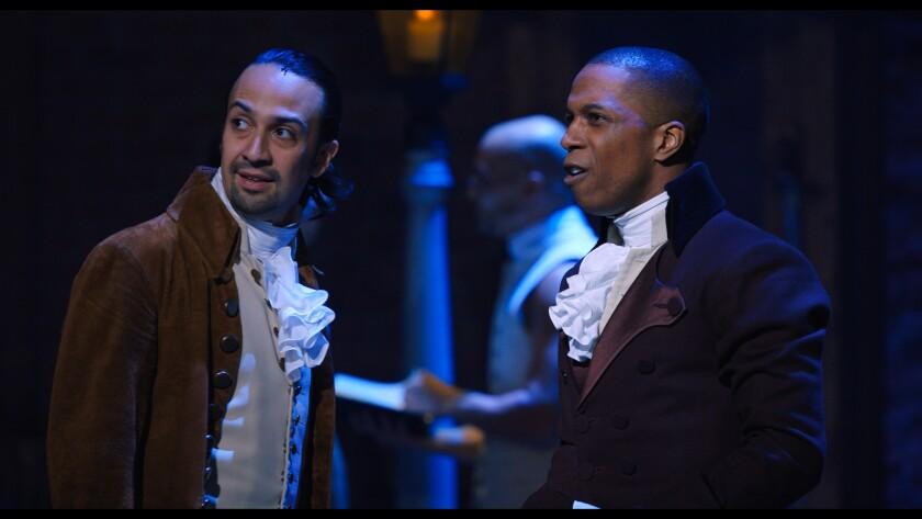 "Lin-Manuel Miranda, left, and Leslie Odom Jr. perform in ""Hamilton"" on the streaming service Disney+."