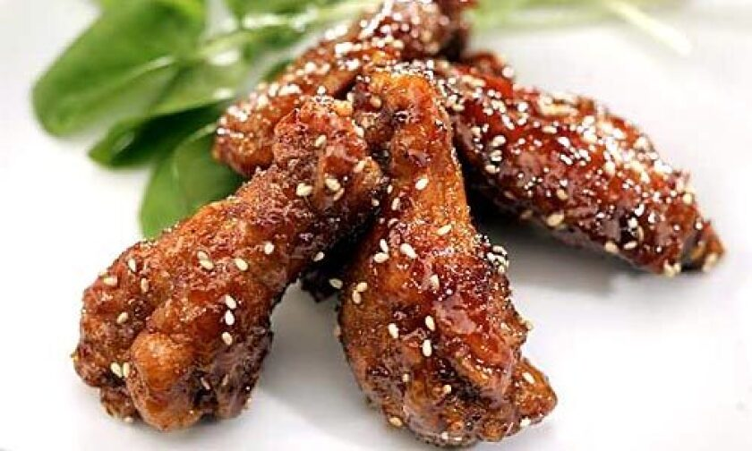WHO NEEDS A DIPPING SAUCE? These deep-fried wings are glazed in a sticky-sweet soy reduction that gets its tang from fresh ginger.