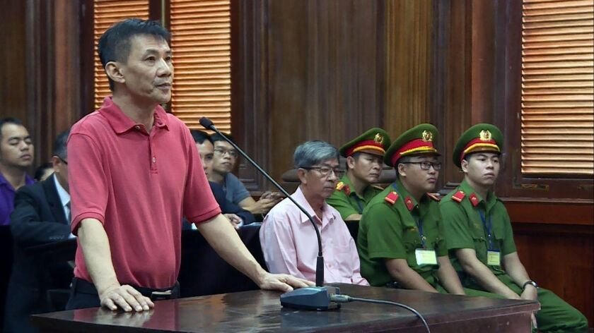 "U.S. citizen Michael Nguyen stands trial Monday in a Ho Chi Minh City courtroom. The married Orange County father was sentenced to 12 years for ""attempting to overthrow the state."""