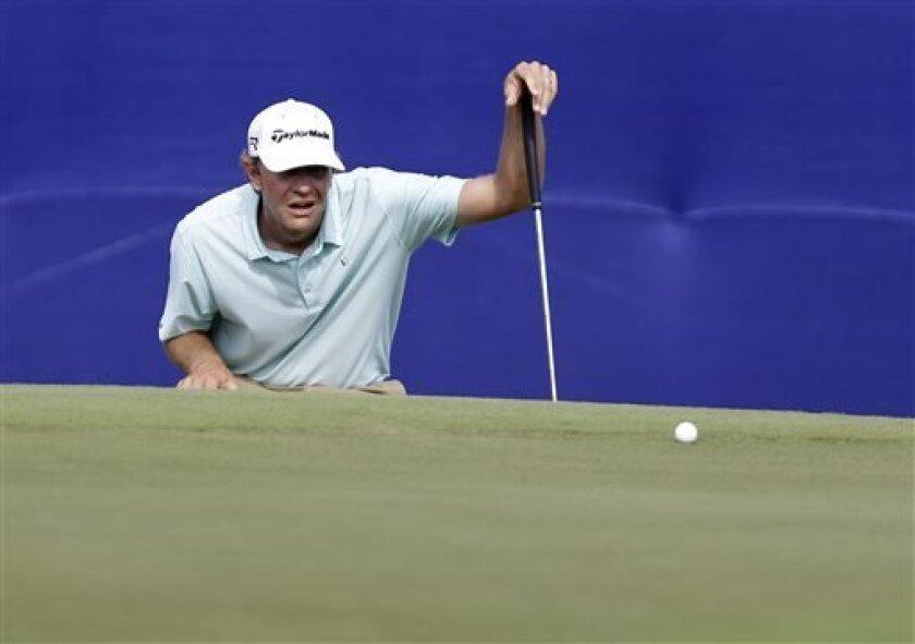 Lucas Glover lines up a putt on the 18th green during the third round of the PGA Zurich Classic golf tournament at TPC Louisiana in Avondale, La., Saturday, April 27, 2013. (AP Photo/Gerald Herbert)
