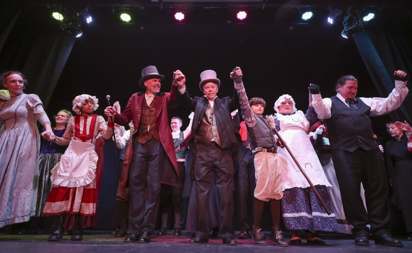 """Cast members take a bow after a dress rehearsal of the Julian Theater Company's """"A Christmas Carol"""" at Julian High School on Thursday, Dec.12, 2019 in Julian, California."""