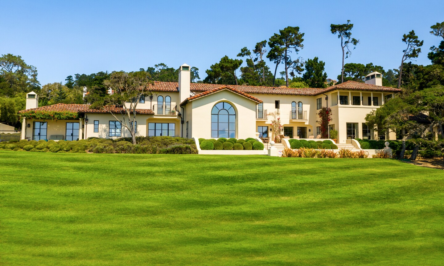 The 10,000-square-foot Mediterranean mansion includes a putting green, chipping area and golf simulation room.