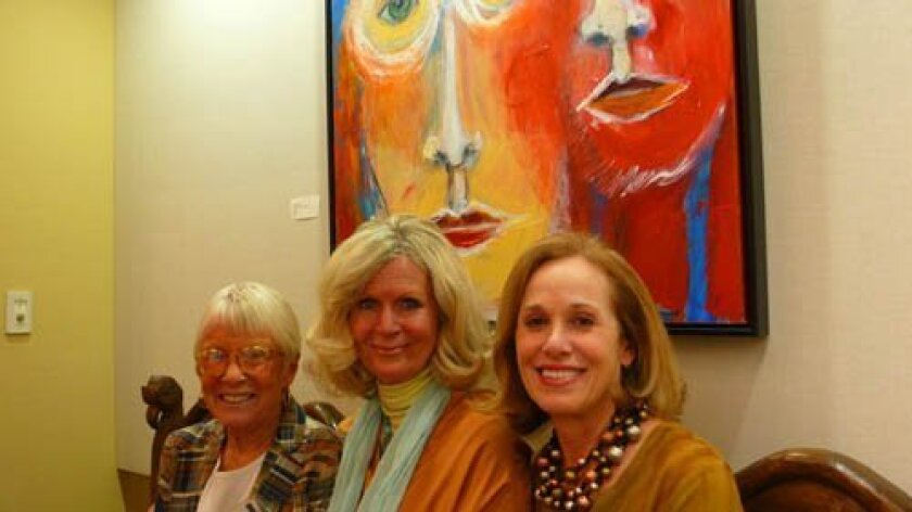 La Jolla librarian Catherine Greene, Arlene Powers and Patricia Jasper-Clark and 'Watching You Watching Us' by Fran Carter