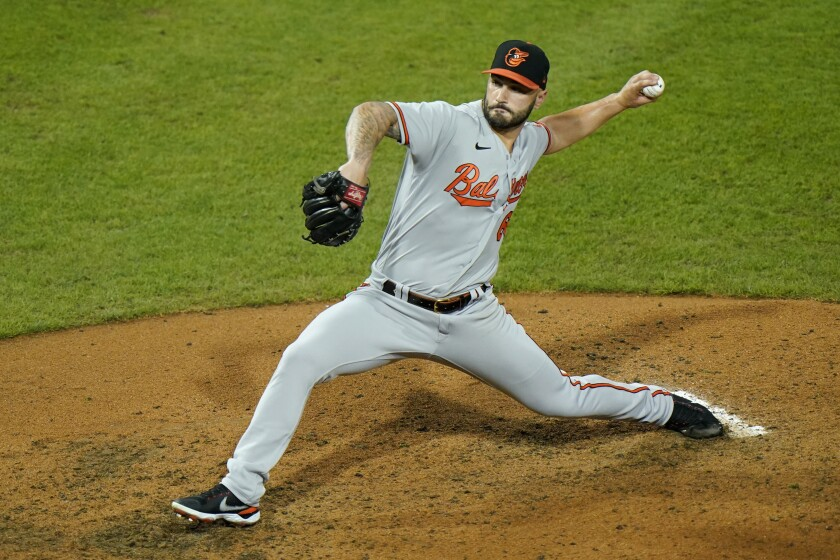 Baltimore Orioles' Tanner Scott pitches during the sixth inning of a baseball game against the Philadelphia Phillies, Tuesday, Aug. 11, 2020, in Philadelphia. (AP Photo/Matt Slocum)