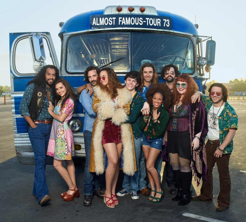 "The cast of the Old Globe Theatre's world-premiere musical ""Almost Famous,"" photographed at Pechanga Arena San Diego. From left: Brandon Contreras, Julia Cassandra, Colin Donnell, Solea Pfeiffer, Casey Likes, Drew Gehling, Storm Lever, Matt Bittner, Katie Ladner and Gerard Canonico."