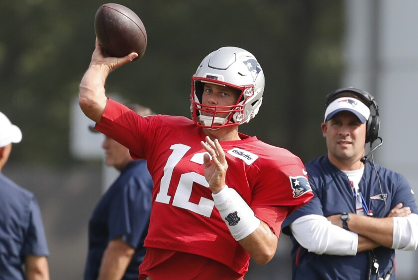 New England Patriots quarterback Tom Brady throws during a joint practice with the Detroit Lions on Aug. 6 in Allen Park, Mich.