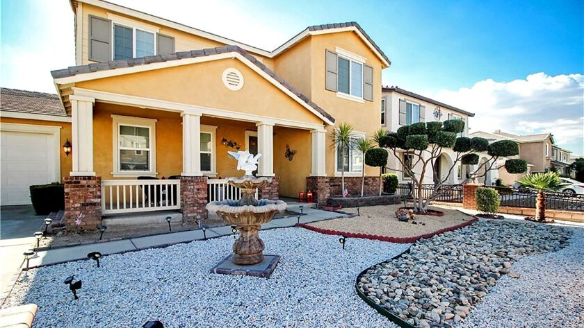 VICTORVILLE: Vibrant walls of olive and powder-blue spruce up the living spaces in this two-story ho