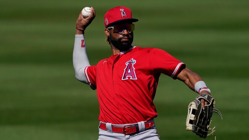 Angels outfielder Jo Adell throws during a spring training game.