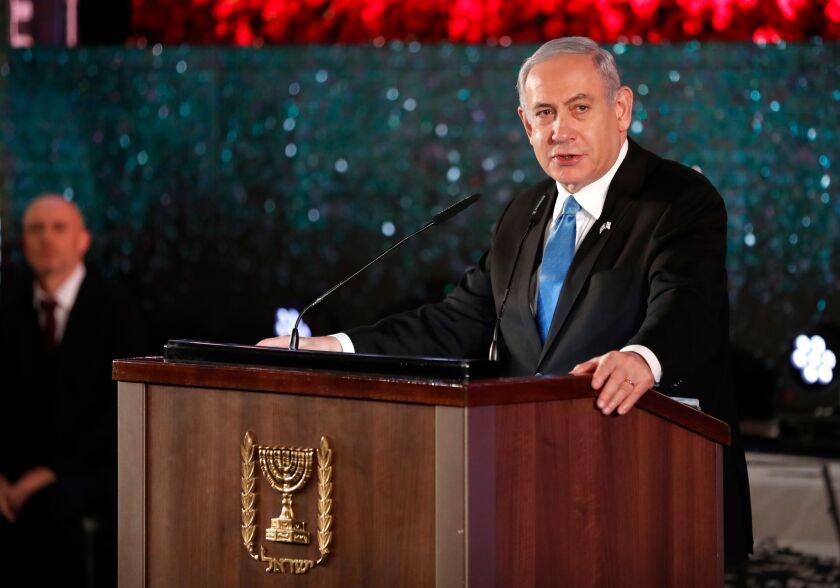 Israeli Prime Minister Benjamin Netanyahu speaks Jan. 23 at a ceremony in Jerusalem.