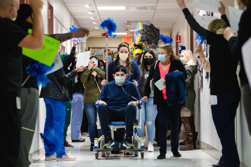 At Scripps Memorial Hospital La Jolla on Tuesday morning, Eduardo Moreno is congratulated by staff as he leaves hospital.