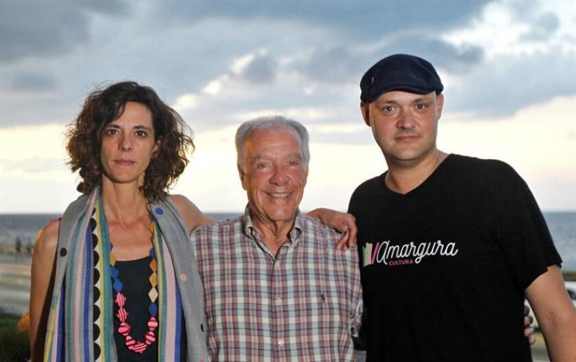 "A photo dated Nov. 13, 2018, of Spanish historians and documentary filmmakers Montserrat Sala Egean (left) and David Barba Serra (right) and Jorge Ribalaigua, the son of Constante Riablaigua, Havana's ""cocktail king,"" during an interview with EFE on the terrace of Havana's Hotel Riviera. EPA-EFE/Yander Zamora"