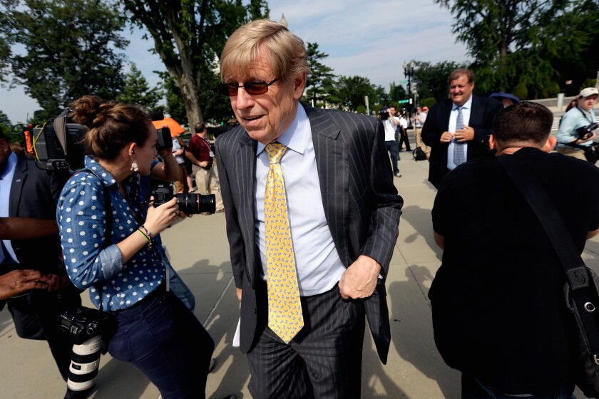 """Attorney Ted Olson, seen in 2013, told ABC's """"This Week"""" that Apple has cooperated with federal authorities but must """"draw the line at re-creating code, changing the iPhone."""""""