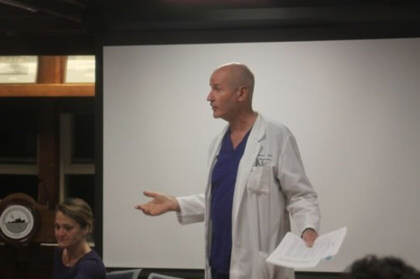 Dr. Dan Harper discusses possible negative health effects due to Electric and Magnetic Fields (EMF) radiation. Ashley Mackin photos