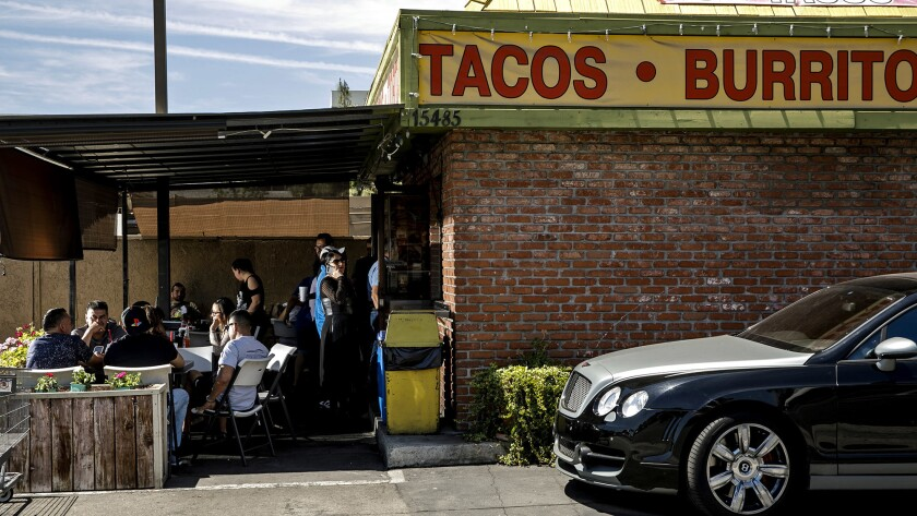 The lunchtime crowd waits to order at Teddy's Tacos in City of Industry.