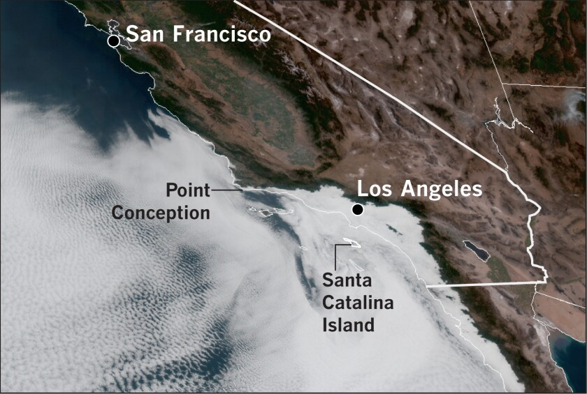 A satellite photo taken at 8:10 a.m. PDT on Thursday shows marine clouds spreading inland from the immediate coast.