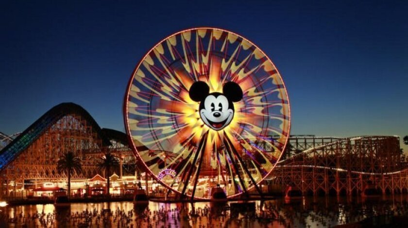 Mickey's Fun Wheel and the California Screamin' roller coaster are seen at dusk at Disney California Adventure Park.