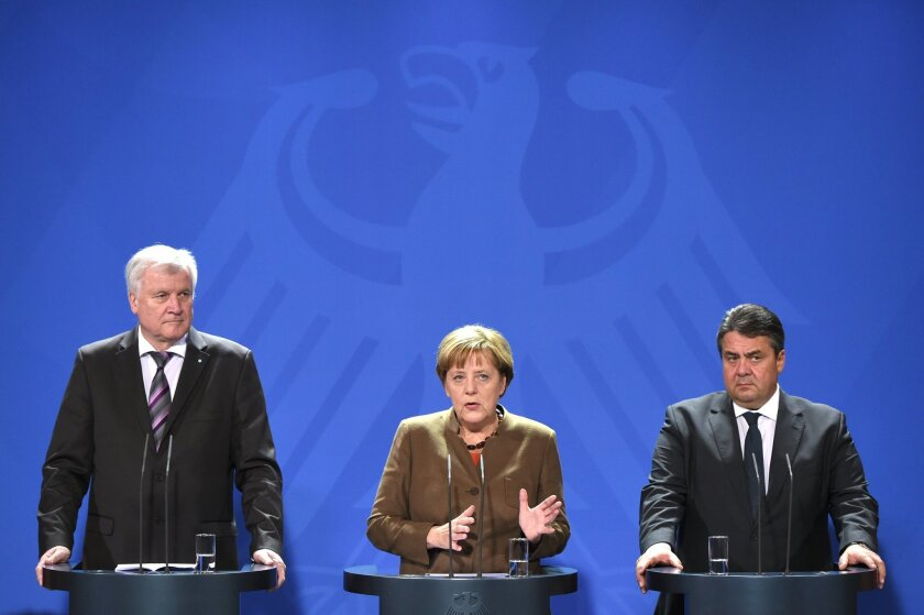 The heads of the German government's coalition parties, Chancellor Angela  Merkel of the Christian Democratic Union party, center, Bavarian governor  Horst Seehofer of  the Christian Social Union party, left , and vice chancellor Sigmar Gabriel of the Social Democrats, right, give a short press sta