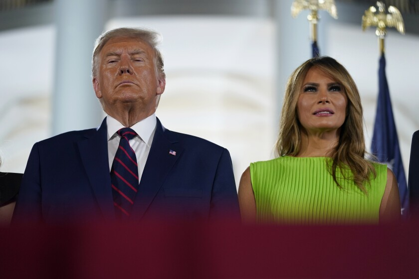President Donald Trump and first lady Melania Trump stand on stage on the South Lawn of the White House on the fourth day of the Republican National Convention, Thursday, Aug. 27, 2020, in Washington. (AP Photo/Evan Vucci)