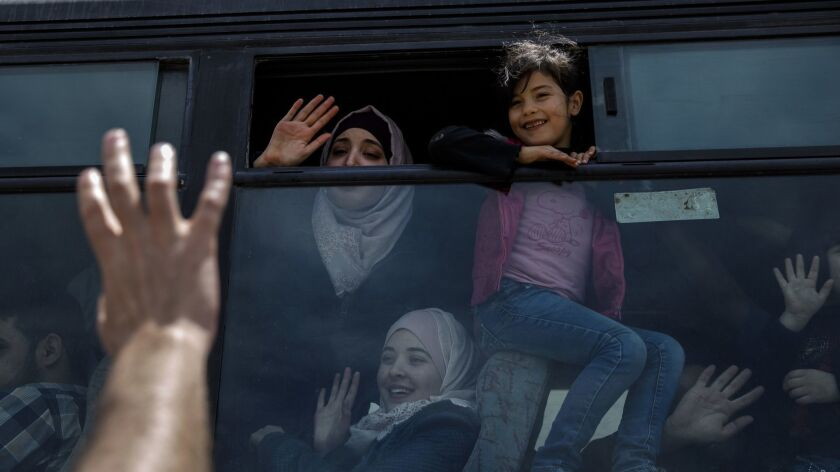 RAFAH, GAZA STRIP -- SUNDAY, MAY 13, 2018: Emad Abu Safia waves goodbye to his children Nadeen Abu S