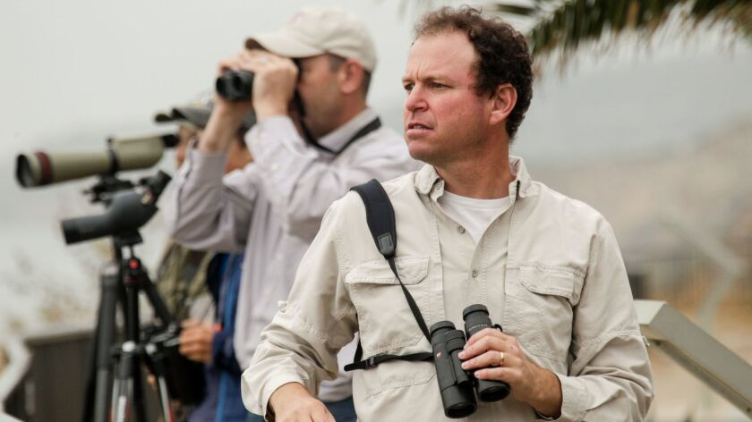 Dan Cooper, right, leads a team of naturalists at White Point Nature Preserve looking for birds. A t