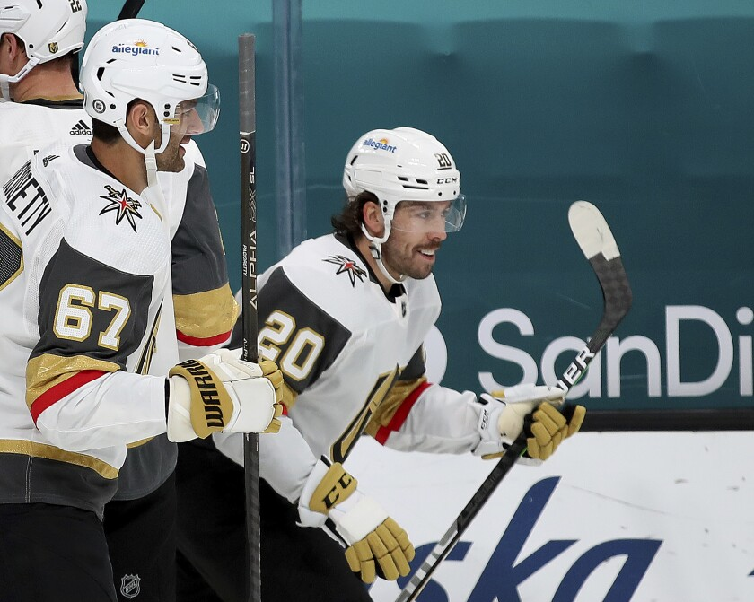 Vegas Golden Knights left wing Max Pacioretty (67) celebrates with center Chandler Stephenson (20), who scored a goal against the San Jose Sharks during the first period of an NHL hockey game in San Jose, Calif., Friday, March 5, 2021. (AP Photo/Josie Lepe)