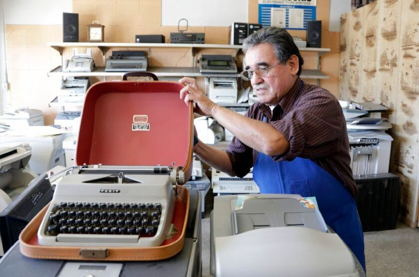 SAN GABRIEL, CA -- JANUARY 04, 2018: Martin Quezada repairs typewriters at his International Office Machines shop in San Gabriel. A renewed interest in typewriters, especially among the younger people and street poets, has slowly brought in a few more machines for repair or refurbishing. (Myung J. Chun / Los Angeles Times)
